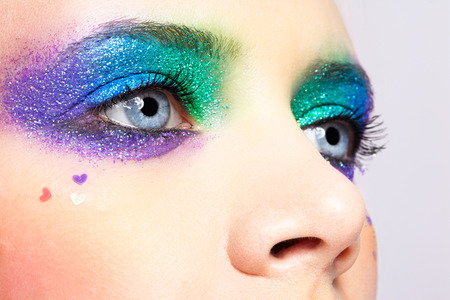 Closeup shot of shining holiday spangled female eye makeup 免版税图像 - 28456911