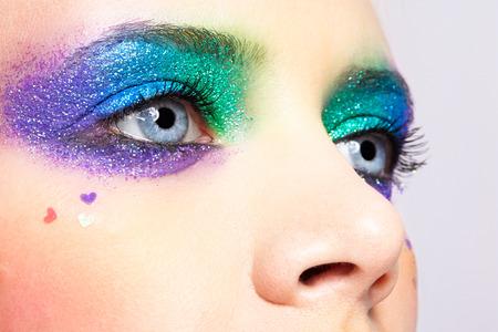 Closeup shot of shining holiday spangled female eye makeup