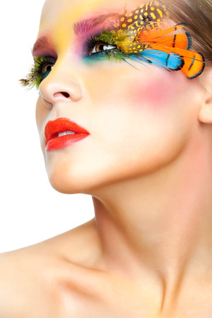 collarbone: Young pretty woman face with false feather eyelashes fashion makeup
