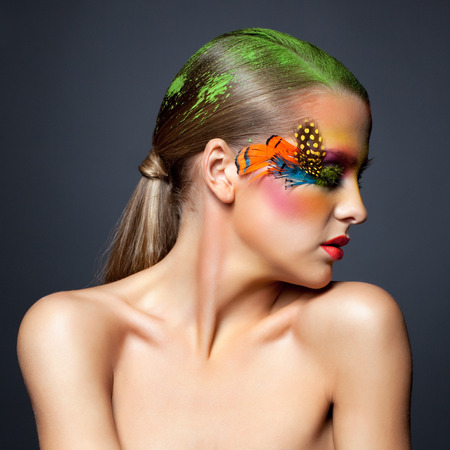 collarbone: Young pretty woman face with false feather eyelashes fashion makeup and closed eyes Stock Photo