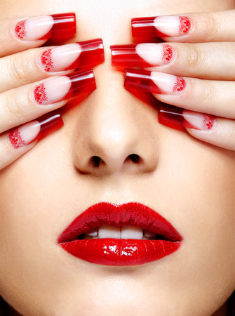 french model: Face with eyes closed by fingers with acrylic french nails manicure Stock Photo