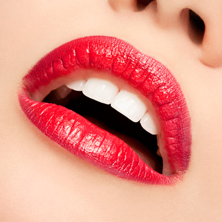 Closeup of woman mouth with red lips photo