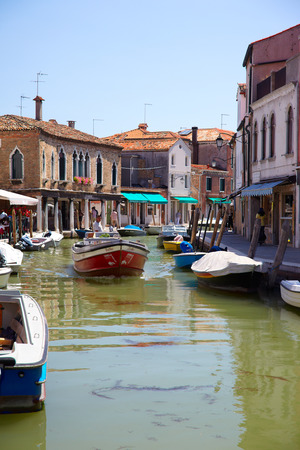 manin: MURANO, ITALY - JUNE 26, 2012  View on canal Rio dei Vetrai and embarkments dei Vetrai and Daniele Manin in Murano, Italy