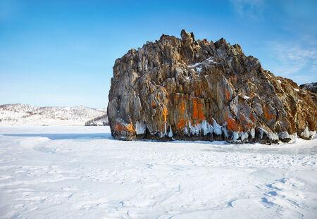 Rock in frozen siberian Baikal Lake in winter photo