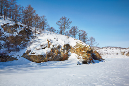 arctic landscape: Rock in frozen siberian Baikal Lake in winter