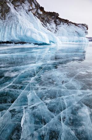 Rocks frozen into the ice of siberian Baikal Lake in winter