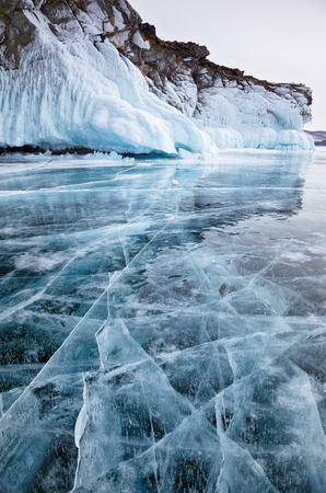 Rocks frozen into the ice of siberian Baikal Lake in winter