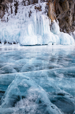 Rocks frozen into the ice of siberian Baikal Lake in winter photo