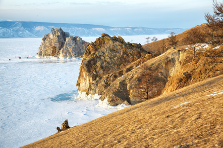 Rock Shamanka on cape Burkhan on Olkhon island in Siberian lake Baikal in winter time photo