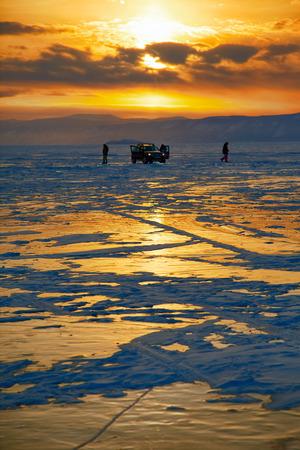 Sunset over siberian Baikal lake in winter photo