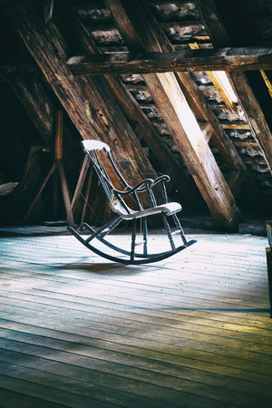 Vintage rocking chair on deserted old attic floor in Round Tower in Copenhagen, Denmark.