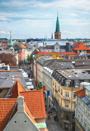 birds scenery: The view from the Round Tower on Copenhagen red roofs and the Tower of Nicolaj Kirke in the distance, Denmark. Stock Photo