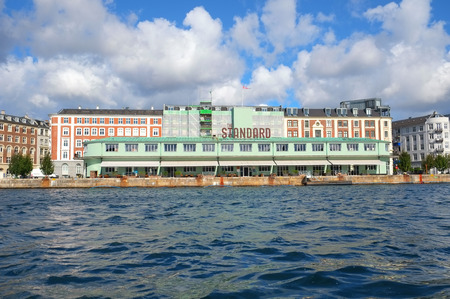 nicknamed: COPENHAGEN, DENMARK - AUGUST 22, 2014: A restaunt complex Standard on the Havnegade. The oval building on the quay (Havnegade, 44), nicknamed the pencil case due to irs shape, is a former custom house and ferry terminal. Thebuilding was designed b Editorial