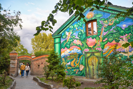 COPENHAGEN, DENMARK - AUGUST 22, 2014: The house painted by author graffiti at the entrance to Christiania in Copengagen, Denmark. Christiania,  also known as Freetown Christiania (Danish: Fristaden Christiania) is a self-proclaimed autonomous neighbourho