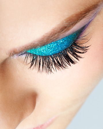 Close-up shot of young beautiful womans eye zone make-up