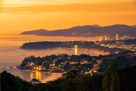 point of view: View on Sunset in western coast of Phuket island, from Karon View Point, Thailand. Stock Photo