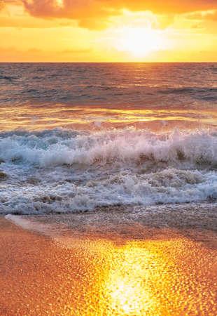 Sunset on Mai Khao beach in Phuket, Thailand photo