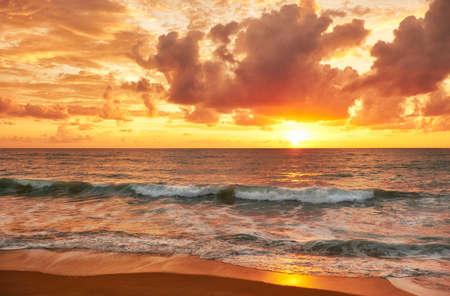 breaking wave: Sunset on Mai Khao beach in Phuket, Thailand