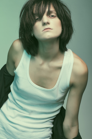 emaciated: Androgyny female model in Heroin chic style. Old style tinted image