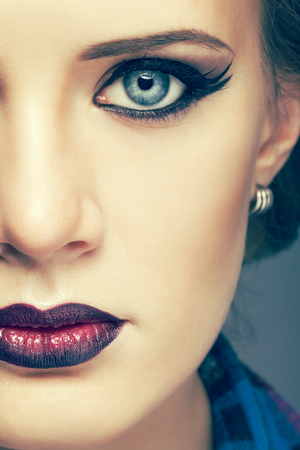 bicolor: Face of young beautiful woman with day makeup