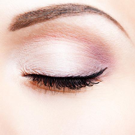 Close-up shot of closed female eye makeup