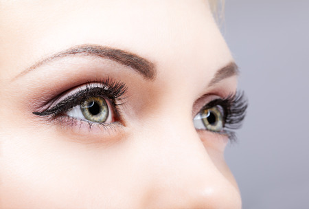 female face: Close-up shot of female eyes makeup