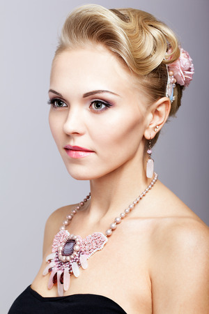 hairpin: Young blonde woman in black dress and necklace