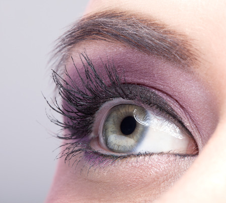 make up eyes: Close-up shot of female eye make-up in pink color