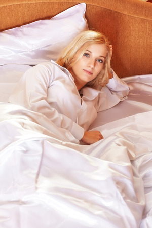 long toes: Young happy  blonde woman in the bed Stock Photo