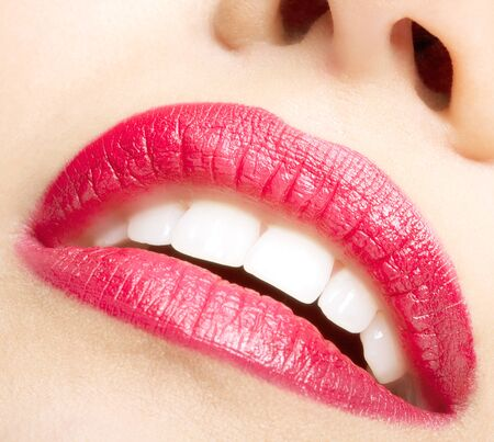 Smiling female red lips and healthy white teeth closeup shot with mouth open photo