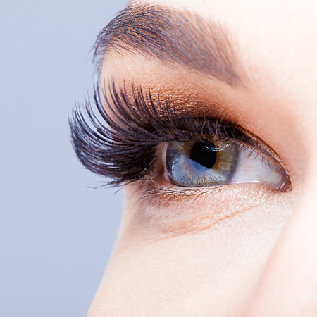 Female eye with long eyelashes closeup shot