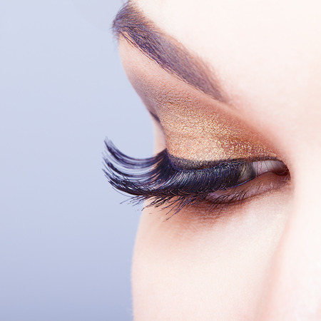 make up eyes: Female eye with long eyelashes closeup shot