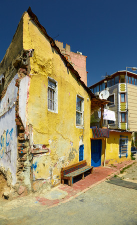 residential settlement: The old yellow house on the residential street in the Eminonu district of Istanbul