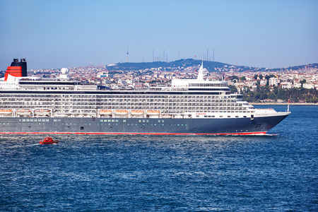 queen elizabeth: ISTANBUL, TURKEY - JULY 07, 2014: Queen Elizabeth liner in Bosphorus. Bosporus forms part of the boundary between Europe and Asia and connects the Black Sea with the Sea of Marmara Editorial