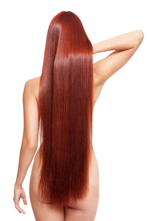 nude woman back: Portrait of beautiful young nude woman with long red hair isolated on white background. View from back side