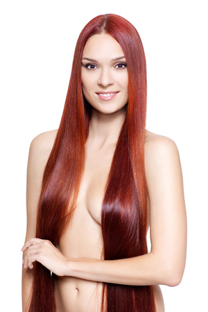 Portrait of beautiful young nude woman with long red hair isolated on white background photo