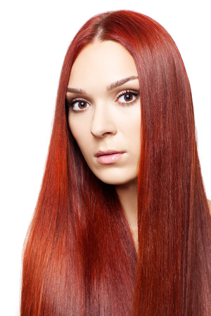 Portrait of beautiful young woman with long red hair isolated on white background photo