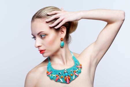beautiful armpit: Beautiful blonde woman in bijouterie  on grey background Stock Photo