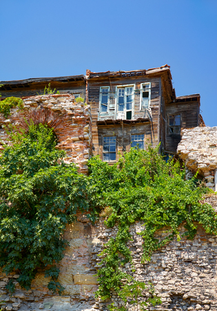 ramshackle: The old wooden house on the hill on the residential street in the Eminonu district of Istanbul