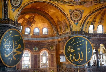 muhammad: ISTANBUL, TURKEY - JULY 9, 2014: The interior view of the Hagia Sophia with 2 gigantic circular-framed medallions with the names of Muhammad and Allah  and Christian Mosaic image of the Virgin  and Archangel Gabriel in the apse  on the top of the main dom