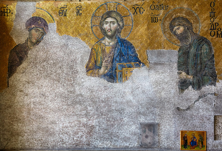 ISTANBUL, TURKEY - JULY 9, 2014: The Deesis mosaic in the interior of Hagia Sophia, Istanbul, Turkey. In this panel the Virgin Mary and John the Baptist are imploring the intercession of Christ Pantocrator for humanity on Judgment Day.