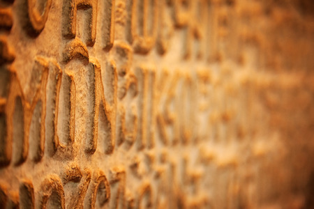 standpoint: Close-up shot of Greek letters in perspective on a stucco copy of decisions taken in the Synod Assembly (Spiritual Assembly) that met in Hagian Sophia in 1166, Istanbul, Turkey, stucco