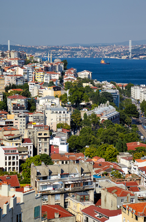 residental: The view from Galata Tower to the residental  houses with Bosphorus Strait and Bridge in the background, Istanbul, Turkey Editorial