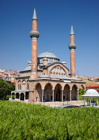 attributed: ISTANBUL TURKEY  10 JULY 2014: Miniaturk park in Istanbul Turkey.  Scale copy of  Manisa Muradiye Mosque in Manisa. Ottoman Sultan Murad has built it in 15831586.  Possibly attributed to Sinan.