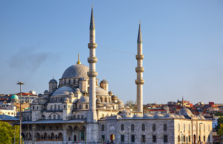 cami: The view of Yeni Cami New Mosque originally named the Valide Sultan Mosque Valide Sultan Camii from Galata Bridge Istanbul Turkey