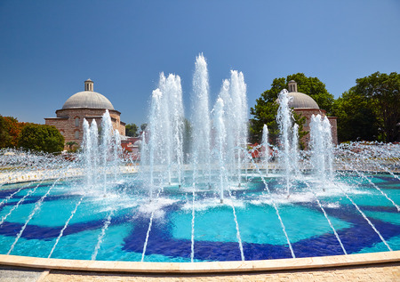 hamam: The view of fountain in Sultan Ahmet Park with Ayasofya Hurrem Sultan Hamam in the background Istanbul Turkey