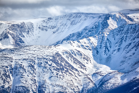 North Chuisky Ridge covered by snow in Altai mountains