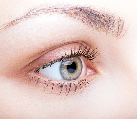 face shot: Close-up shot of female face with eye makeup Stock Photo
