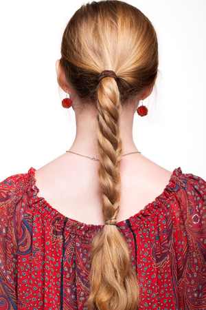 plait: Studio portrait of young woman on white background from back side Stock Photo