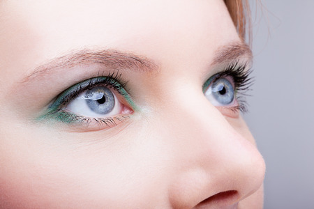 blue eye: Close-up shot of female face with eyes makeup Stock Photo